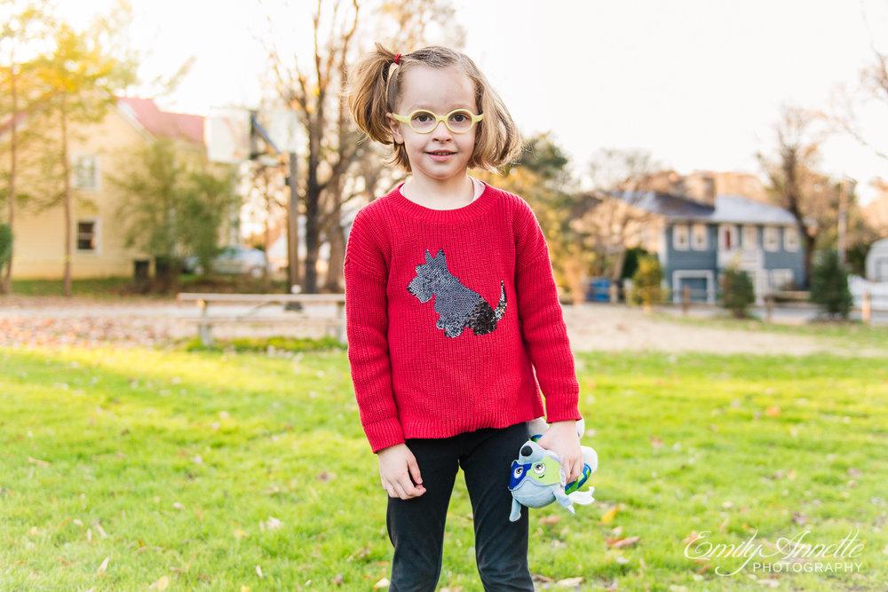 A young girl posing for a photo at Clifton Town Park in Fairfax County, Virginia