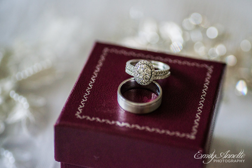 A diamond and silver wedding ring set on a beautiful maroon ring box at Herrington on the Bay in North Beach, Maryland