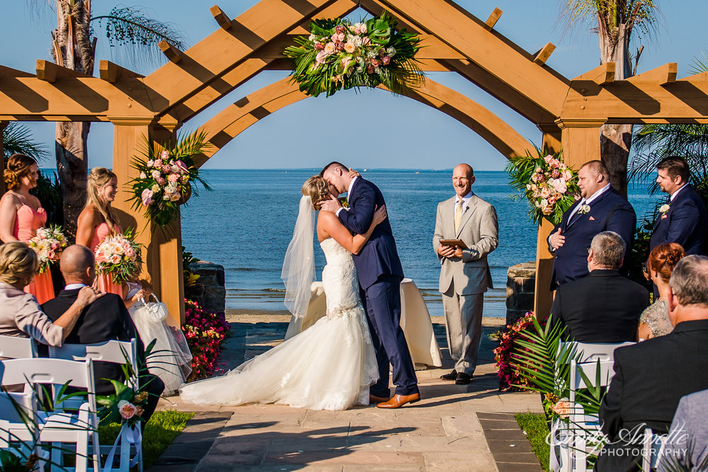 The bride and groom share their first kiss as husband and wife during a wedding at Herrington on the Bay in North Beach, Maryland
