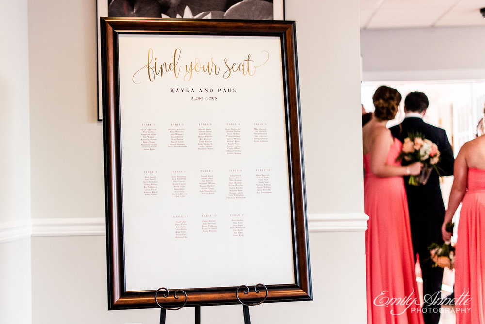 The framed seating chart during a wedding reception at Herrington on the Bay in North Beach, Maryland