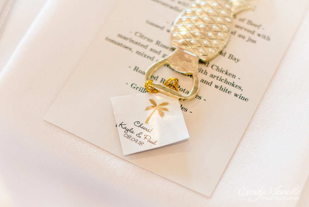 A pineapple bottle opener as a guest favor during a wedding reception at Herrington on the Bay in North Beach, Maryland