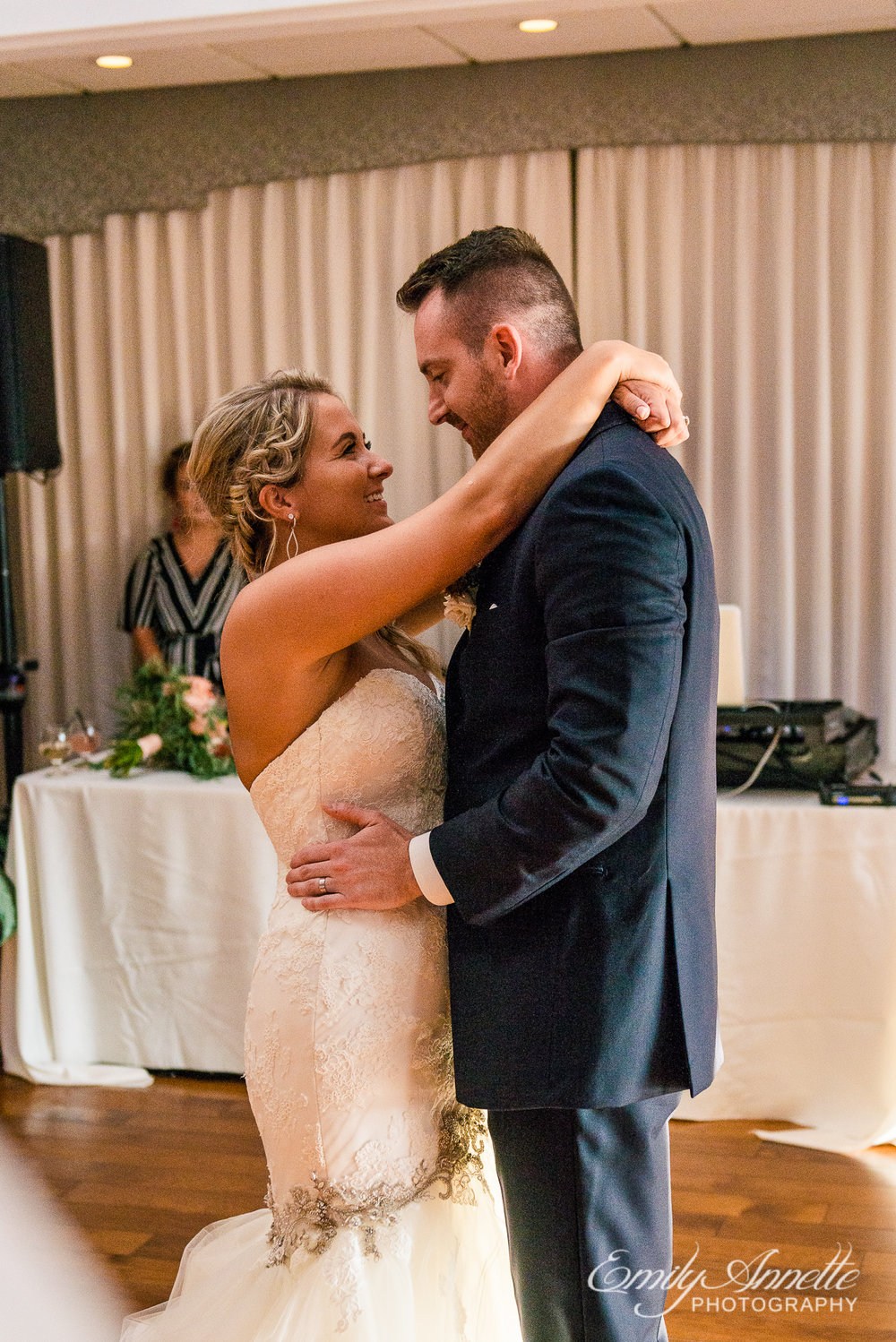 The bride and groom share their first dance as husband and wife during their wedding reception at Herrington on the Bay in North Beach, Maryland