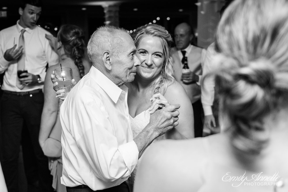 A bride dancing with her grandfather during her wedding reception at Herrington on the Bay in North Beach, Maryland