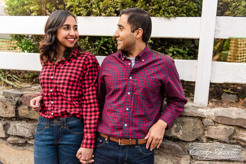 An engaged couple stands along King Street in Old Town Alexandria Virginia during an engagement session
