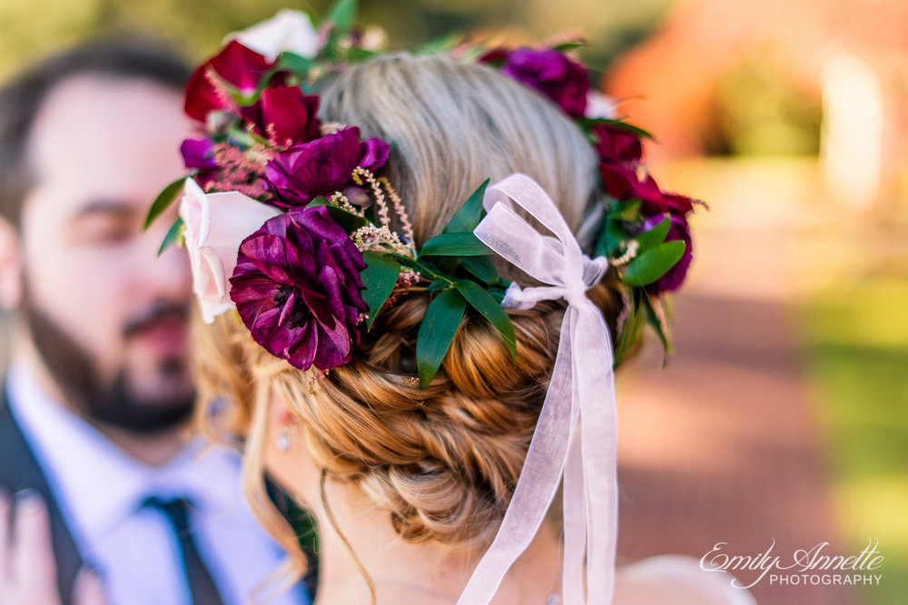 A close up of the beautiful red and purple bridal flower crown worn by a bride before her wedding at Willow Oaks Country Club in Richmond, Virginia