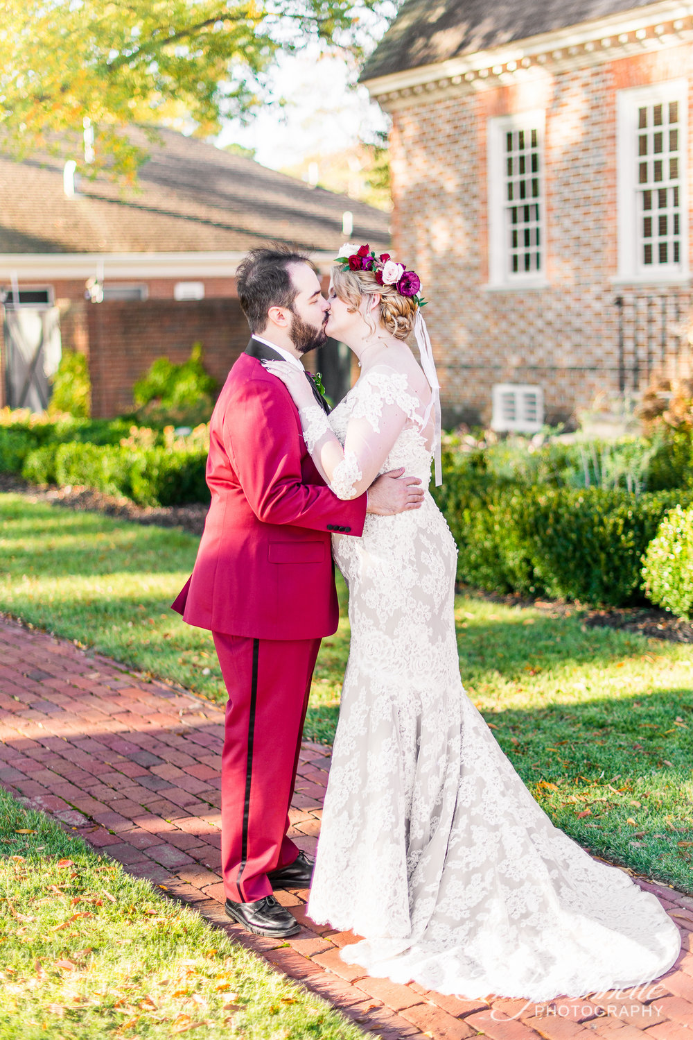 A groom kissing his bride on their wedding day at Willow Oaks Country Club in Richmond, Virginia