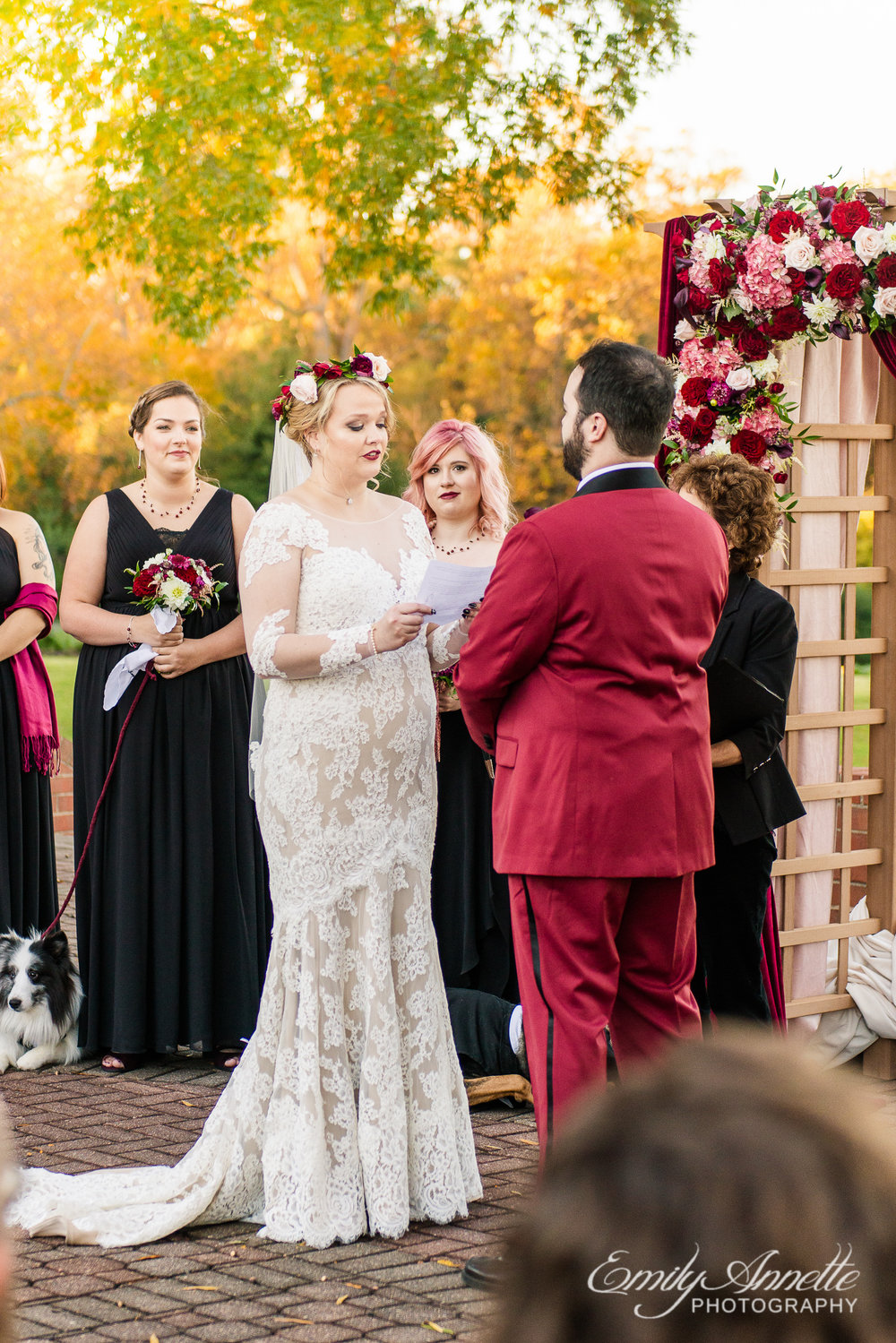 A bride reading her vows to her groom at the altar during an outdoor wedding ceremony at Willow Oaks Country Club in Richmond, Virginia