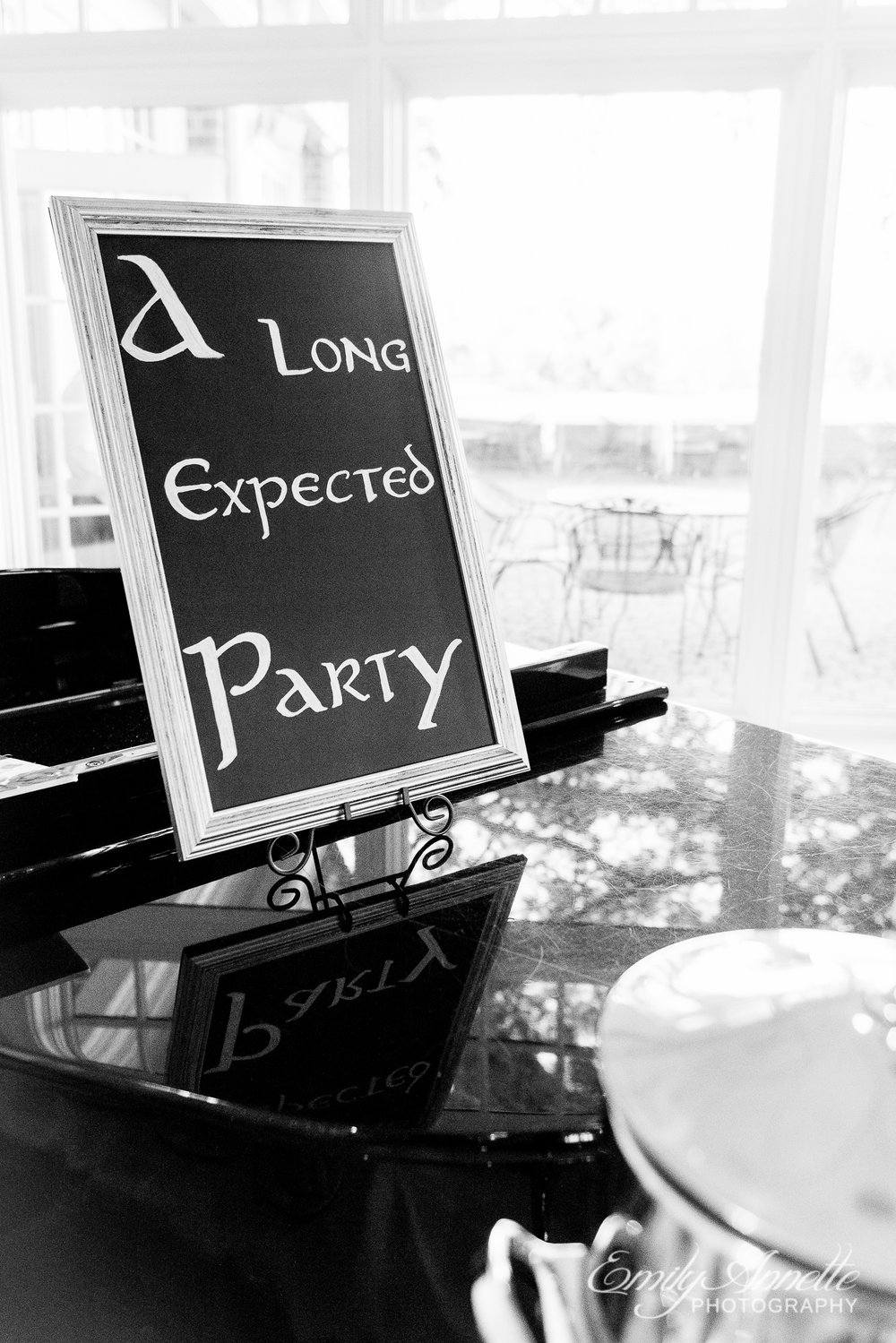 "A sign that reads ""A Long Expected Party"" at a wedding reception at Willow Oaks Country Club in Richmond, Virginia"
