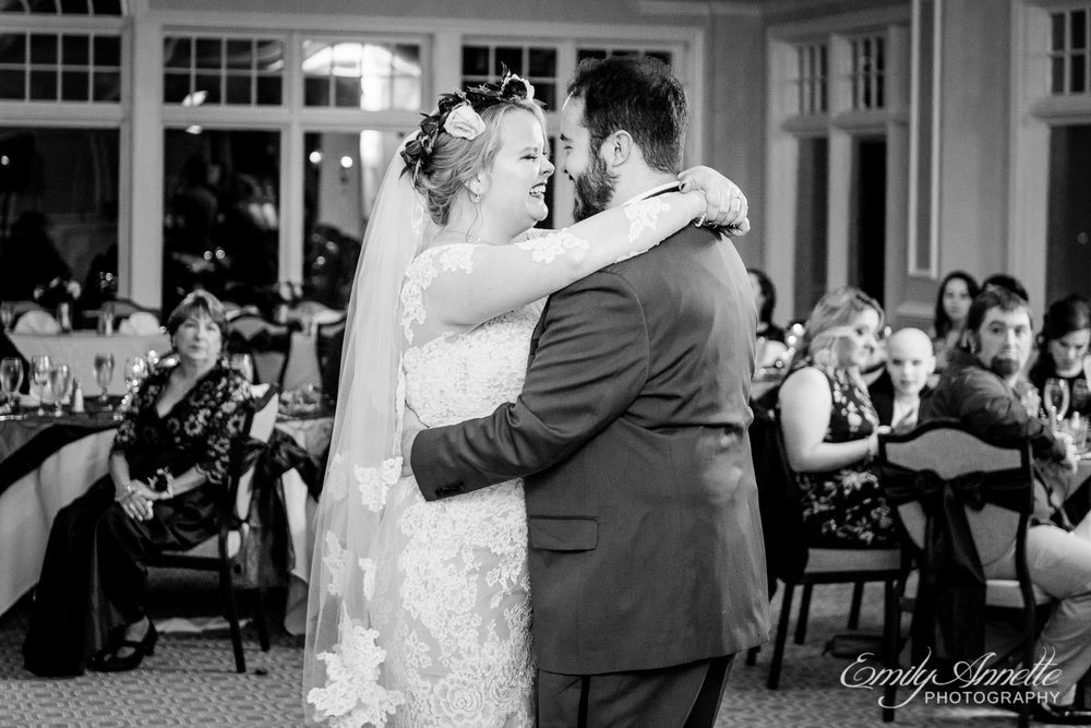 A bride and groom share their first dance as husband and wife during a wedding reception at Willow Oaks Country Club in Richmond, Virginia