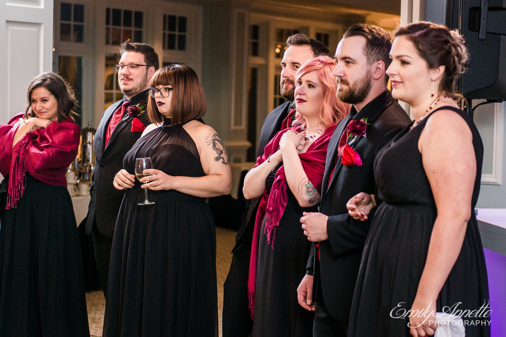 A wedding party getting emotional as they watch the bride and groom share their first dance as husband and wife during a wedding reception at Willow Oaks Country Club in Richmond, Virginia