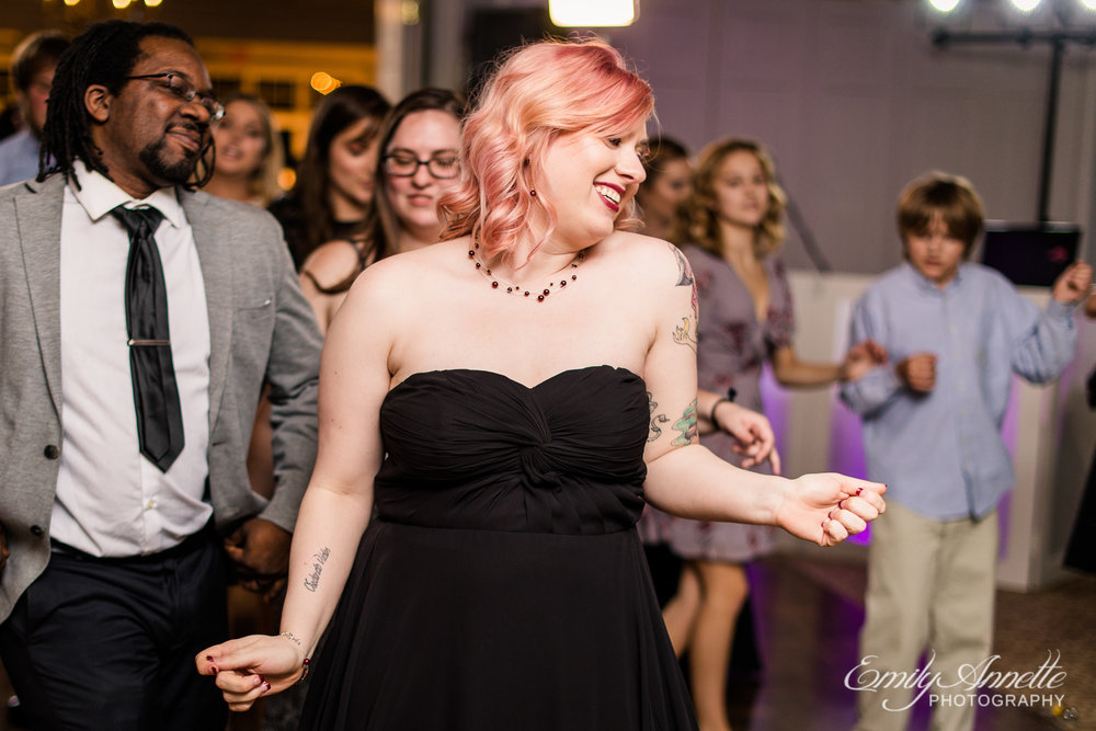 A bridesmaid dancing to the cupid shuffle during a wedding reception at Willow Oaks Country Club in Richmond, Virginia