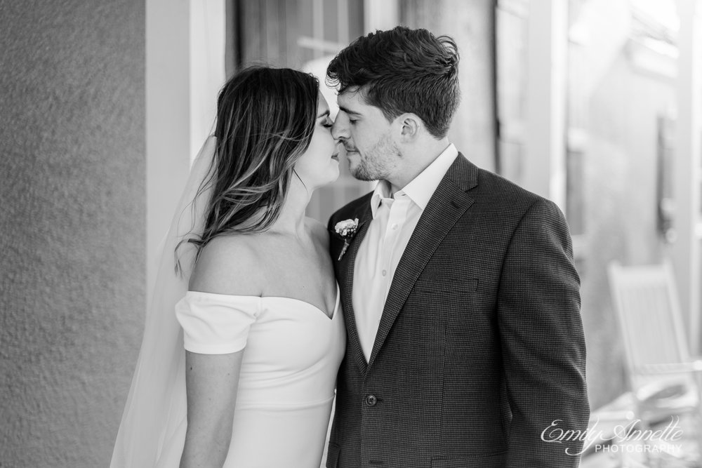 A bride and groom lean in for a kiss on their wedding day at Fleetwood Farm Winery in Leesburg, Virginia