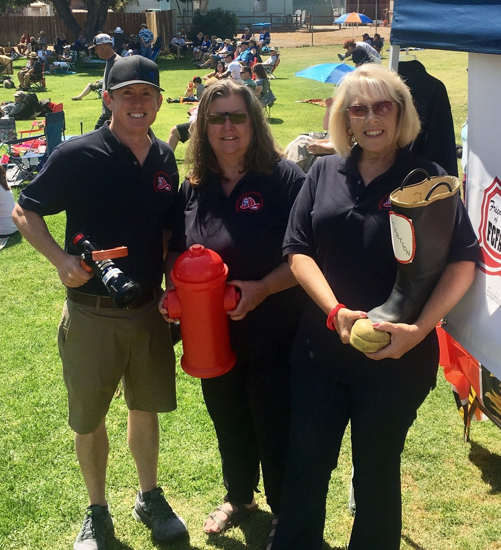 Friends of Five Cities Fire Authority Board Members fundraising at Ramona Garden Park Concert