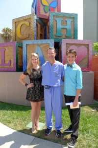 Alex Dale and Madison Curtis present a check to Dr. David Skaggs, Chief   of Pediatric Orthopedics at Children's Hospital Los Angeles