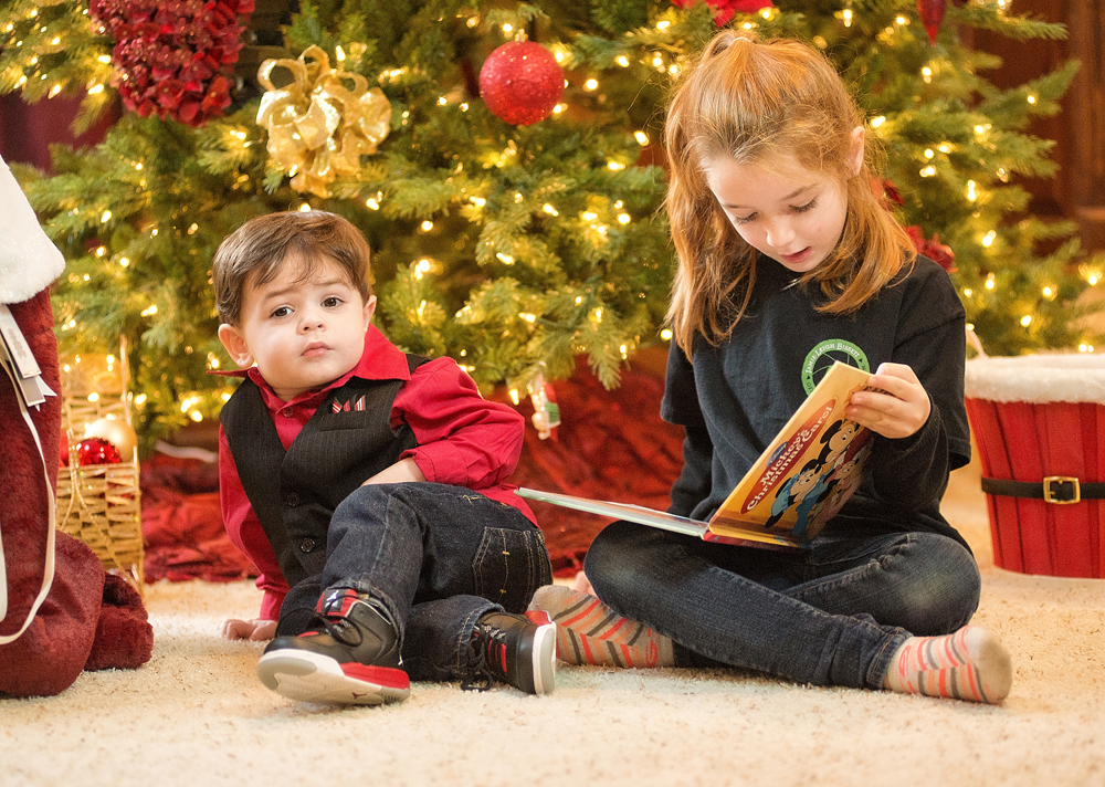 Second cousins Alex and my daughter, Julia, who assisted me during the family portrait session, read Mickey's A Christmas Carol.