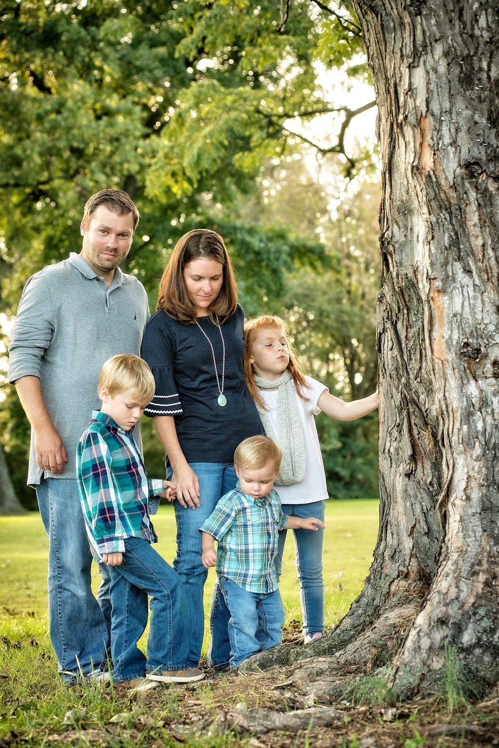 The family was able to gather for a quick snap by the tree before the little cherub sprinted off.
