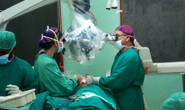 Dr. Jose Piquer (NED Foundation President) and Dr. Maria Santos (Weill Cornell Global Neurosurgery fellow) performing a complex neurosurgical procedure with a last generation neurosurgical microscope.
