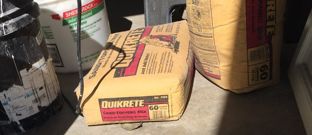 Sand Topping Mix from Quikrete is what was used to spray the first coat(s)