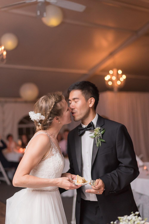 Elkridge-Furnace-Inn-Wedding-Reception-Cake-Cutting-Bride-Groom
