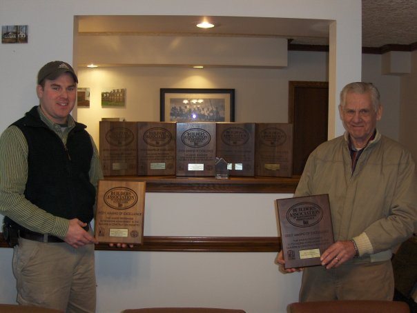 E.J. Chernicky (left) and his grandfather, Emil Chernicky with some of the awards they've won over the years.