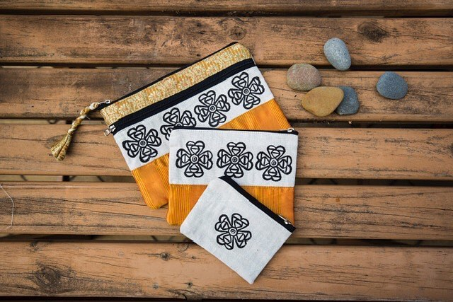 🧡🧡Our three in one bags are cleverly designed to fit snugly into each other and to be used separately as well. Great for holding all the 'lost' items you find in the bottom of your bag. Made from recycled sarees and organic Indian cotton. The beautiful patterns are designed and carved into stamps from rubber sandals that have been sourced from the rubbish. They are then lovingly hand printed by the gypsy women of Sewing the Seeds🧡🧡