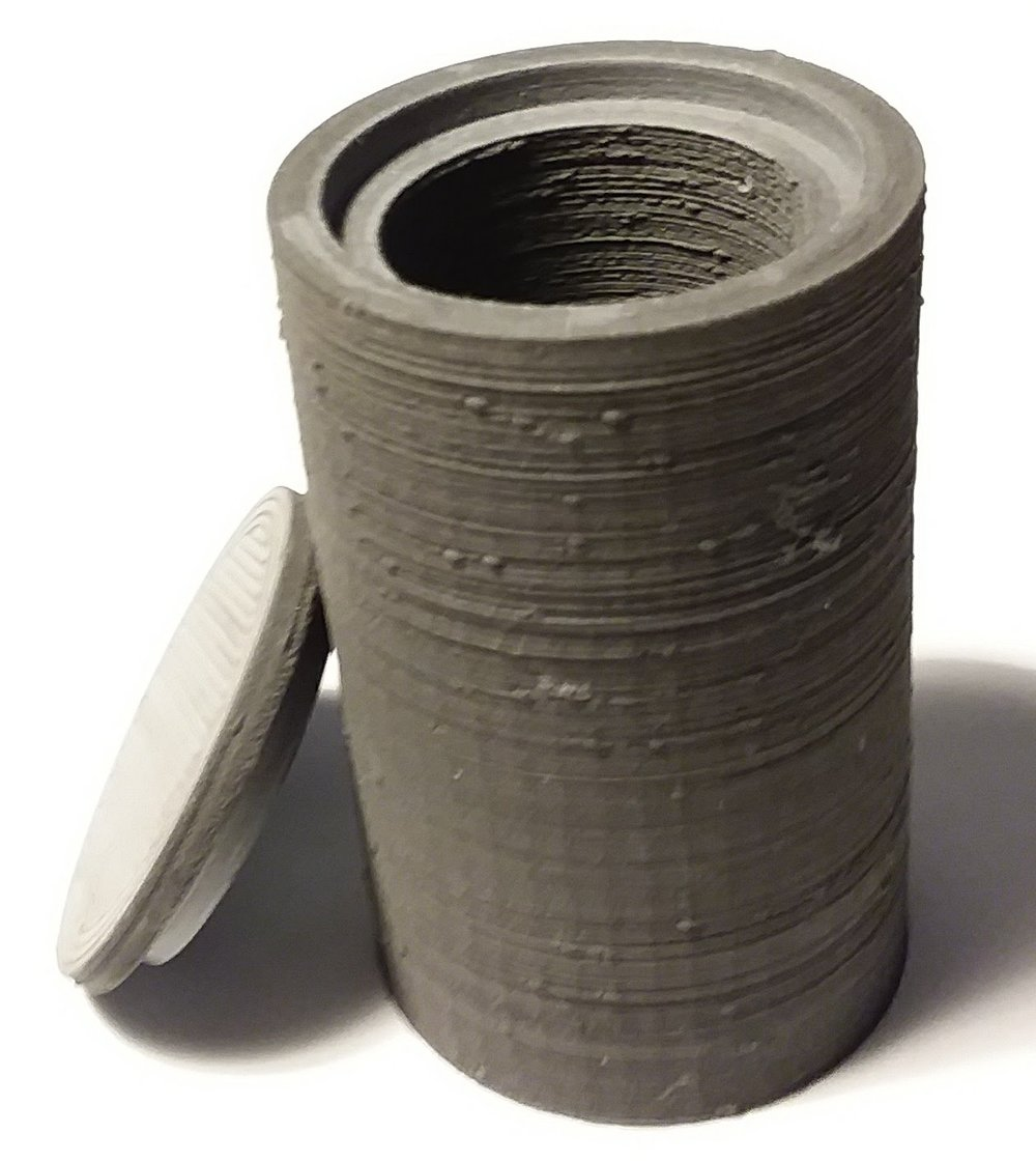 Radiation Shielding - This is a 3D print of a bottle with lid used for transporting radioactive medicine it is equal (or very close to) the density of pure lead.This print is about 94% metal by mass. It's made with tungsten, which is 1.6 times heavier than lead. The whole point of this product is weight, to make the heaviest filament humanly possible. It will be used mostly in radiation management, vibration control and counterweights, marketed under a brand name that already has traction as an injection moldable, super high mass material.This print weighs about a half pound. The container is 8.4cm high without the lid and 8.7cm with it. The outer diameter measures 4cm.