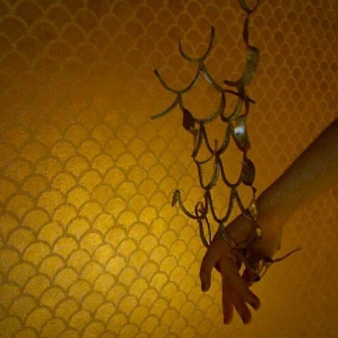 Wall that I stenciled long ago. Still one of my favorites. Metallic gold scales on cream - the entire room!