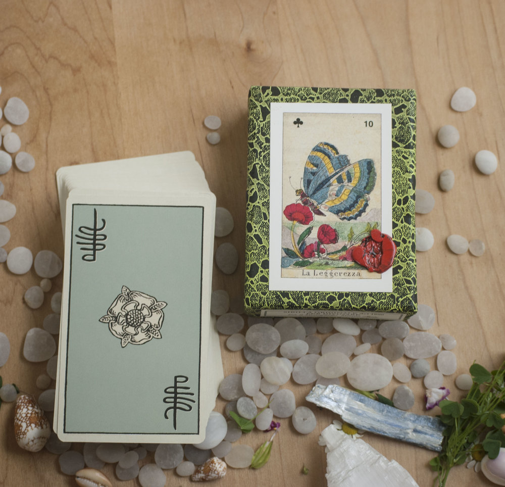 Two tarot decks with an array of crystals