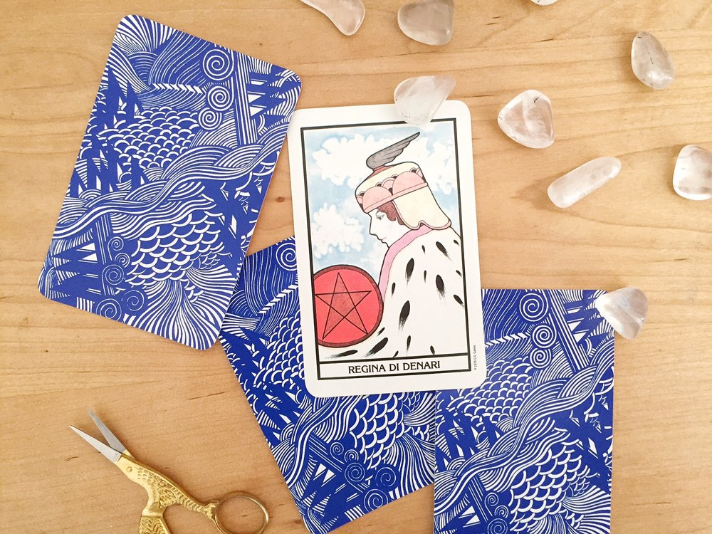 Aquarian tarot array with quartz crystals queen of pentacles