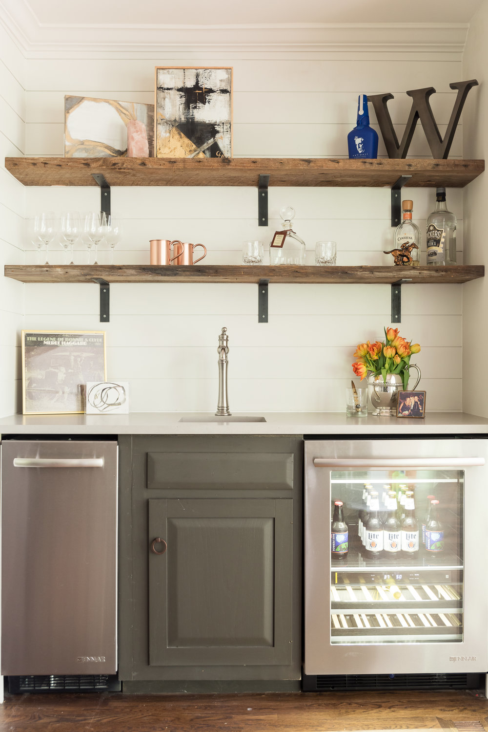 we repurposed a cabinet to build the bar and the same salvaged wood that we used in the kitchen.