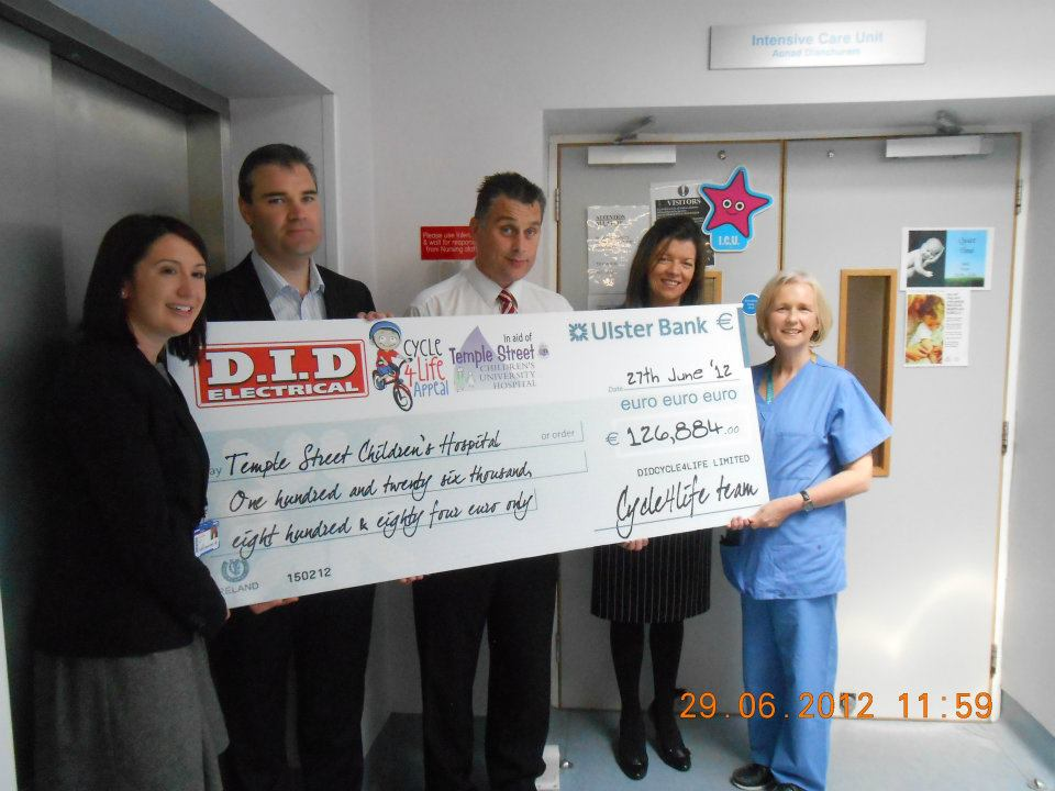 DID Electrical executive team pictured here together with members of Temple Street staff presenting moneies raised from Cycle4Life 2012