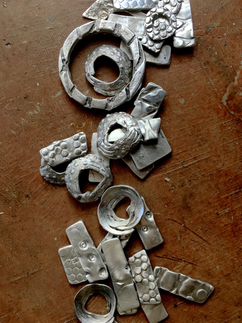 About 25 years ago I made a lot of asymmetrical jewelry and I'm going to channel some of that into some new pieces.  For now just making 'roadkill metal' components and thinking I need to research scrap metal/leftover components places to scour for new things.