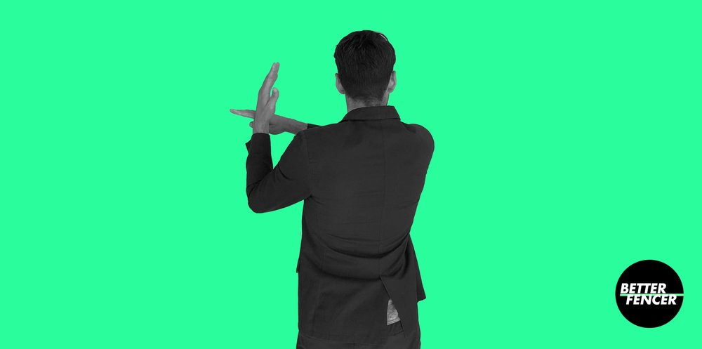 "Fencing hand gesture ""parry"" against right fencer"