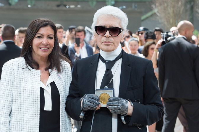 Anne Hidalgo (left) presents Karl Lagerfeld (right) with the highest honour the city can bestow at the end of Chanel's latest couture show on Tuesday.