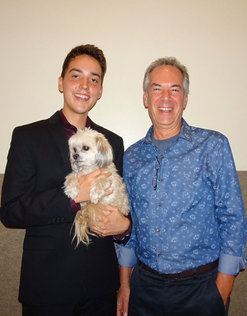 Xavier Jara, with Stephen Aron and photographer, Martha Bihari's dog Max.