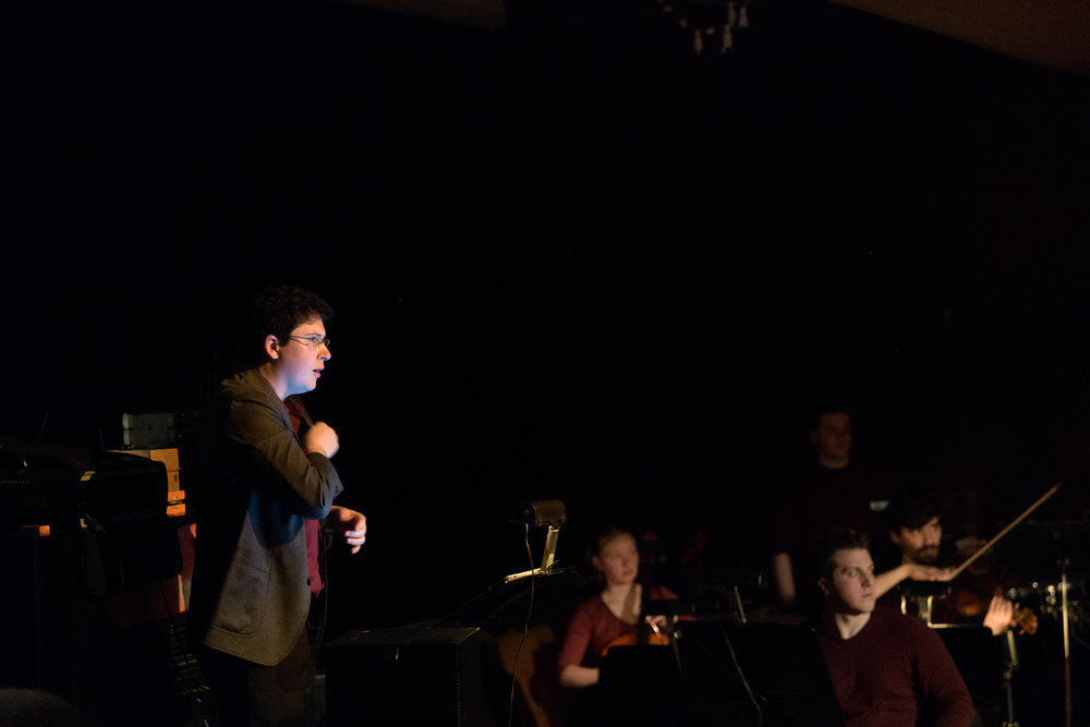 Conductor Matthew Chamberlain during performance; Stephen Fazio sits front right.
