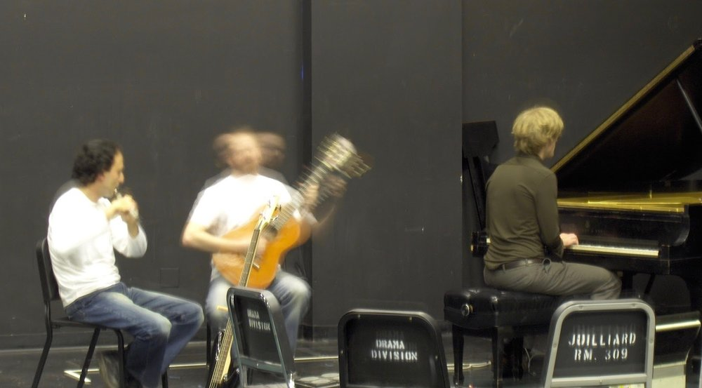 Adam on classical guitar with flutist Arto Artinian and Jonathan Vincent on piano, at a music festival at Juilliard (2003)