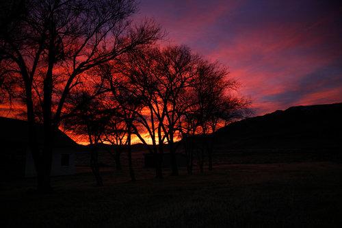John Simpkins - Sunset behind the Old Stone Schoolhouse