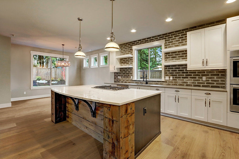 Kitchen Features Numerous Rustic Accents Including Recovered Barn Wood and Full-Height Brick-Styled Backsplash