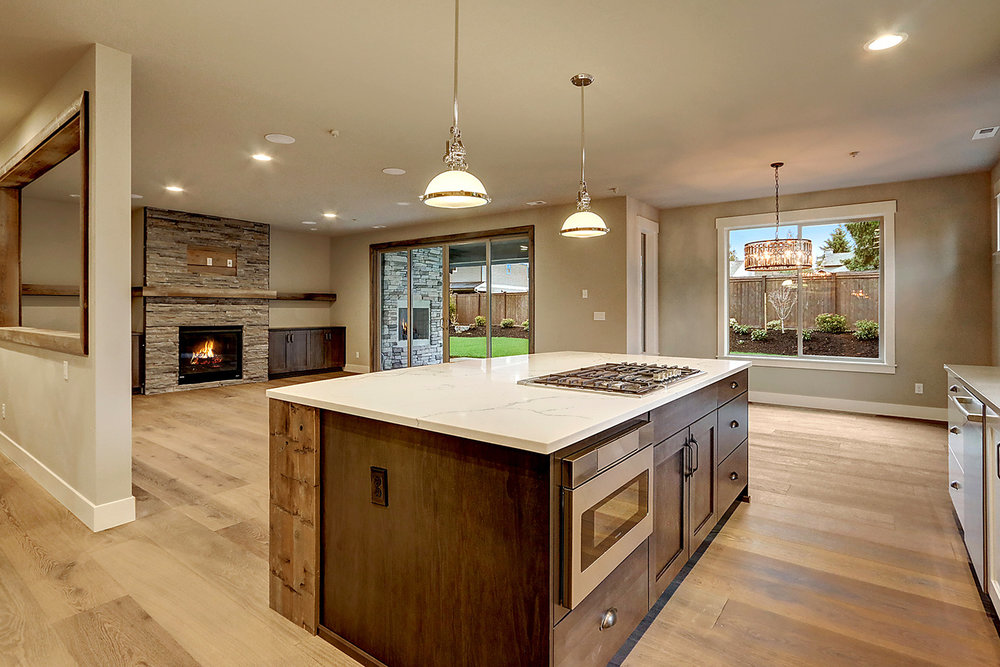 Island Kitchen Overlooks Great Room and Backyard