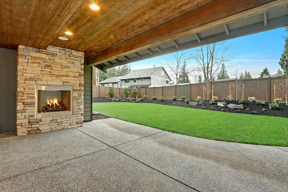 Covered Outdoor Living Room with Gas Fireplace