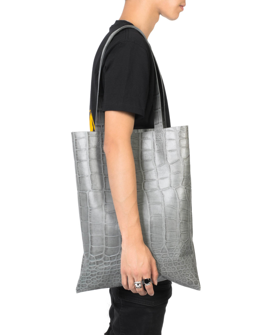 - 4. Leather Tote BagIt looks so good, someone might actually try to grab it off your shoulders. Use with caution. We can't guarantee your safety, but we can guarantee that all eyes will be on you.