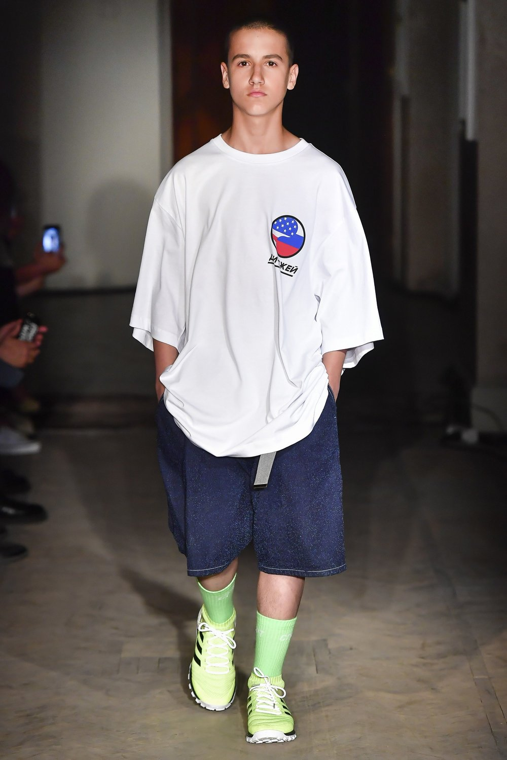 Gosha Rubchinskiy Spring/Summer 2018  returns for a third delivery at  Dover Street Market .  The collection features football inspired tops and shorts.