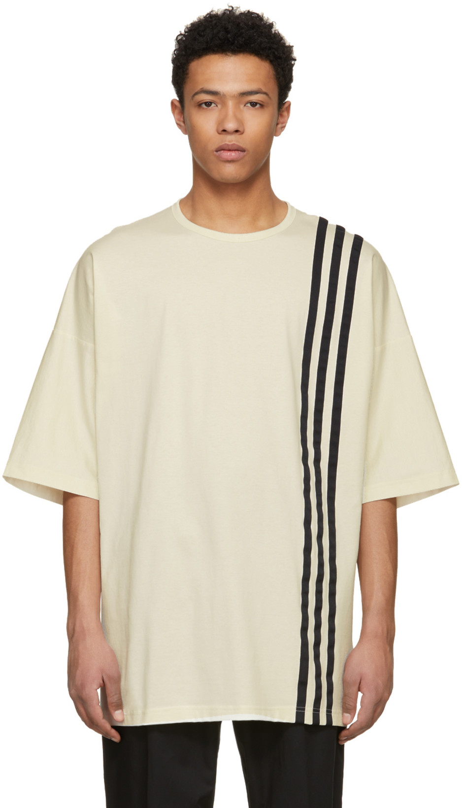 Y-3 - Off-White 3-Stripes T-ShirtIf you're really into the whole oversized tees and sportswear style, this tee will give you both elements.  Style this tee with some AKINGSNY Jameson raw denim for a modern-avant-garde look.