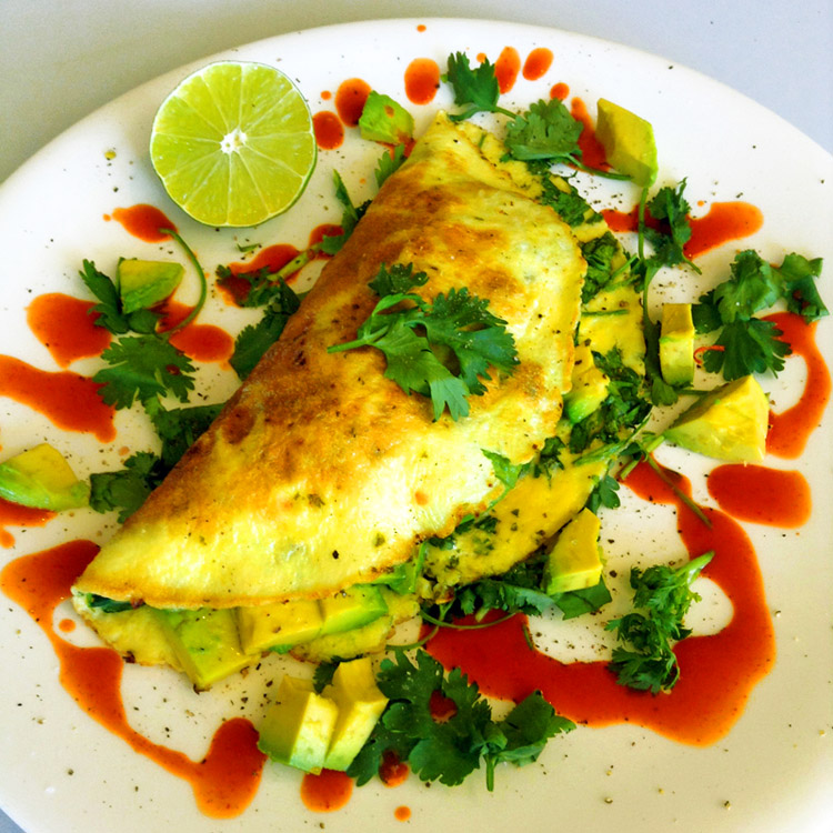 Easy keto omelette recipe with avocado for keto breakfast recipes. Use cilantro and lime.