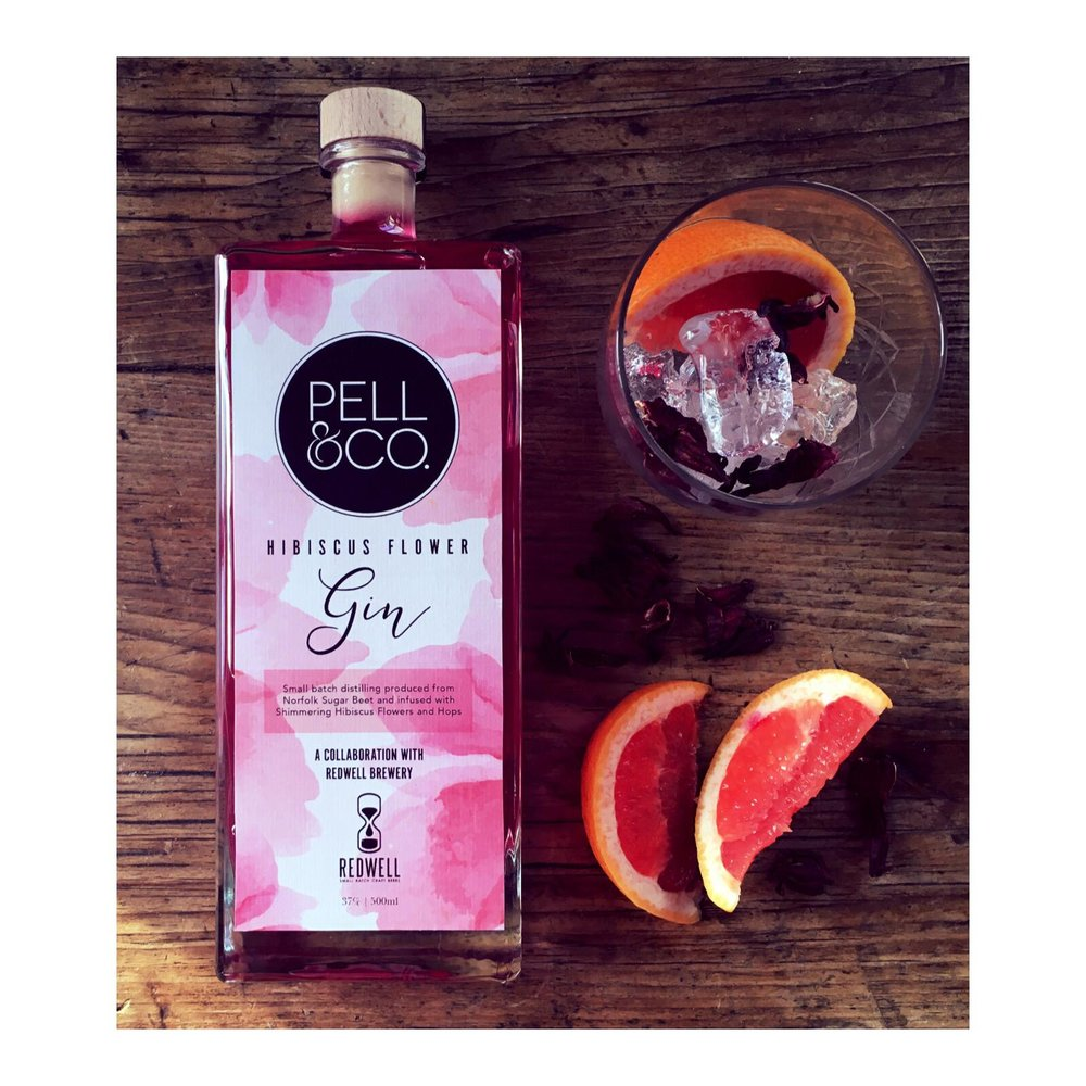 Ice and wedge of pink grapefruit topped with Fever-Tree Aromatic tonic -