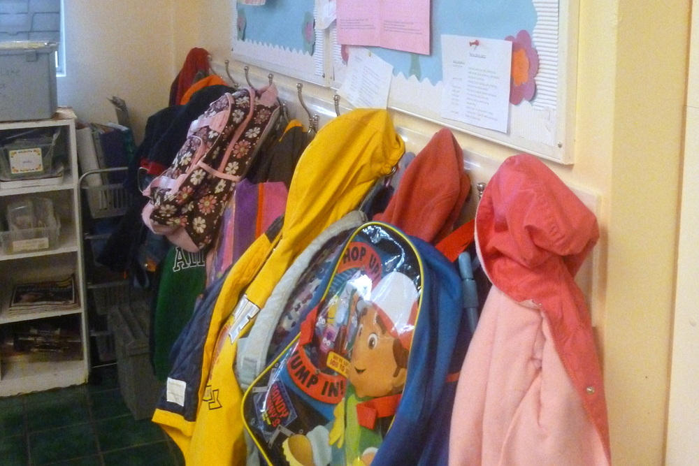 Children hang their own coats and backpacks and learn to pack up their work from their cubbies and belongings at the end of class – preparing them for kindergarten.