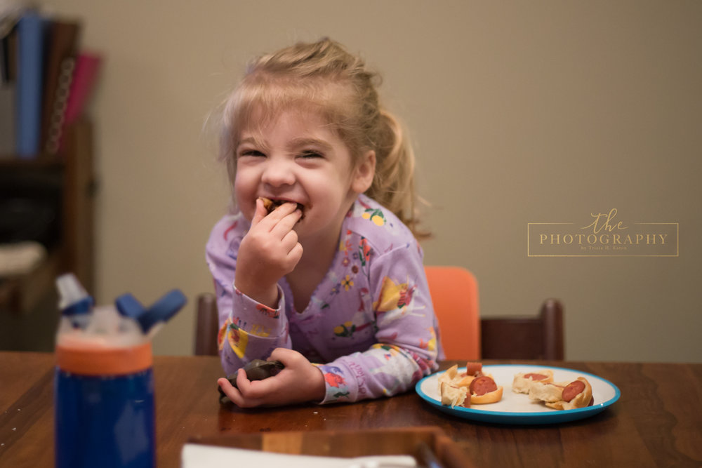 Emma was so excited for her donuts! Cute. Oh, and this was the first time she looked at the camera and actually smiled!