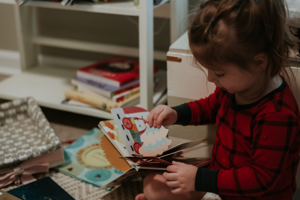 week seven - 1/14/18this girl and her books, she can sit there for hours and loves to read to her baby sister