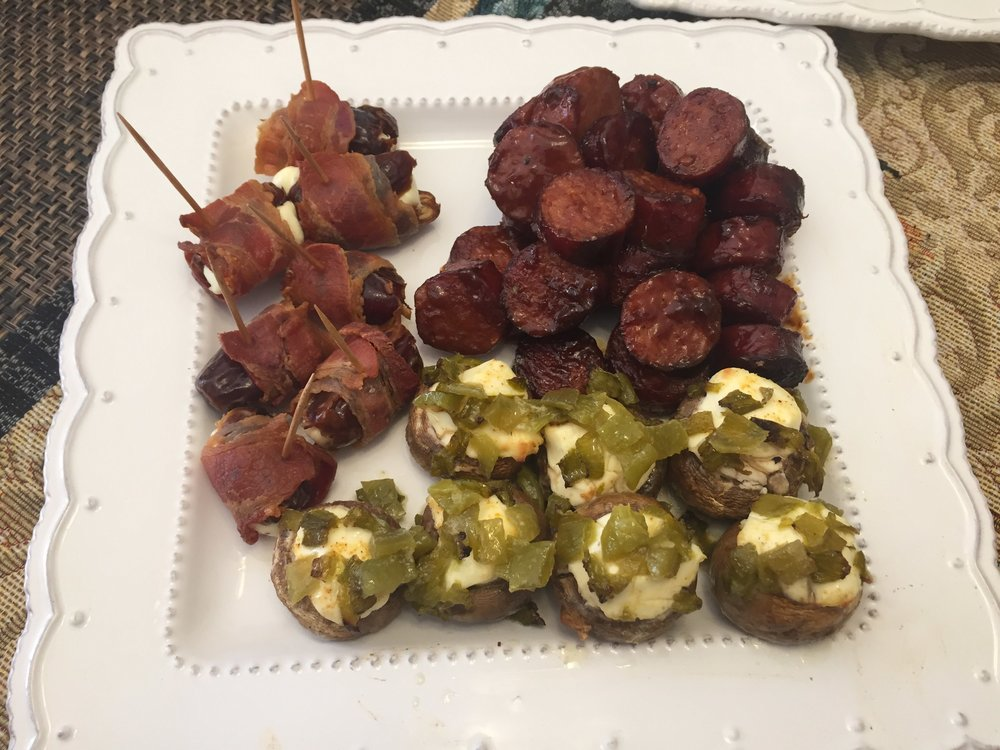 Those fabulous Love Rub mushrooms alongside bacon-wrapped stuffed dates and BBQ kielbasa. All these are available on our catering menu!